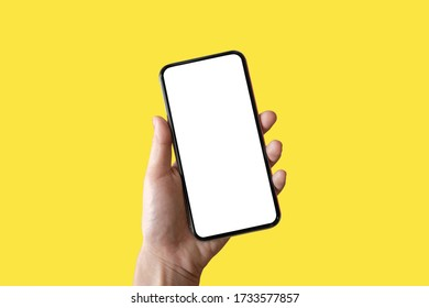 isolated phone in a hand on a yellow backgroud