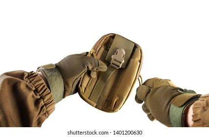 Isolated photo of a first person view arms in tactical jacket and gloves holding olive colored military tactical pouch on white background.