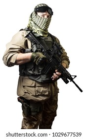 Isolated photo of a fully equipped military soldier standing with rifle and tactical glasses angle view.