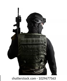 Isolated photo of a fully equipped swat soldier standing with rifle back view pose.