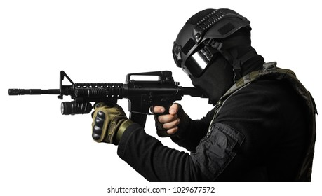 Isolated photo of a fully equipped swat soldier standing and aiming with rifle profile view.