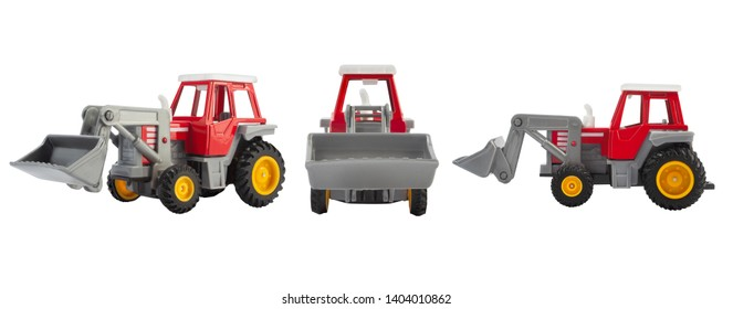 Isolated photo of a red toy tracktor standing front, side and angle view on white background.