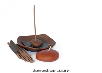 isolated photo of some candles and incense stick
