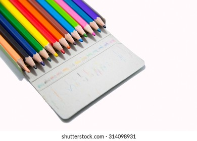 Isolated photo of used color pencils in the package.