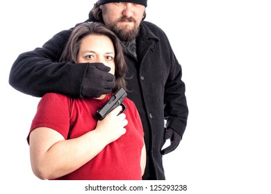 Isolated photo of a woman in red shirt being assaulted from behind by white male in  black coat, hat and gloves. The mans hand is covering the woman's mouth with fear in her eyes. copy space for text
