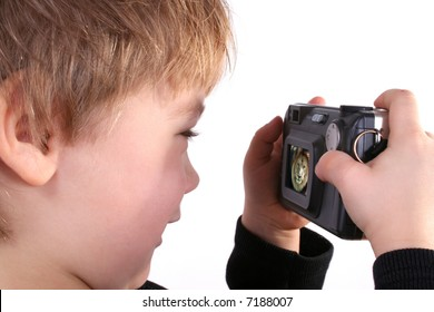 Isolated photo of young boy taking a photograph with compact digital camera