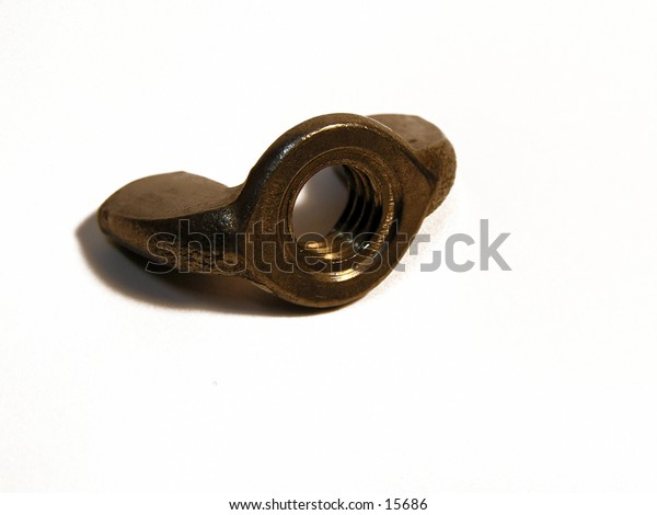 An isolated photograph of a wing nut