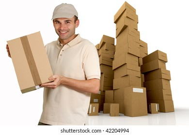 Isolated picture of a  cheerful messenger holding a cardboard box from a huge pile