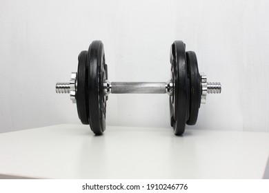 Isolated picture of a dumbbell 15kg over white background.