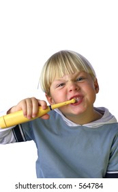 An isolated picture of a young boy cleaning his teeth
