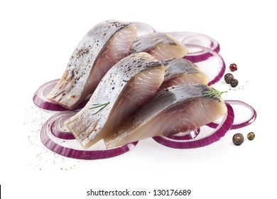 isolated pieces of salt fillet herring with onion