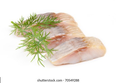 isolated pieces of salt herring fish wiht dill