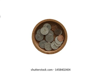 Isolated pile of US coin in small tray