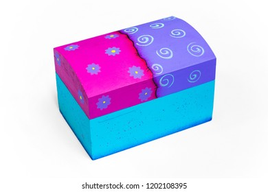 Isolated pink, purple and blue coffer with painted flowers on the top with white background.