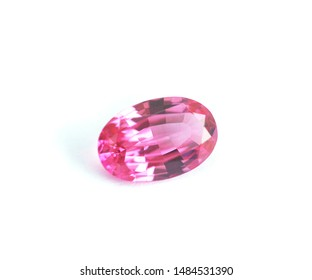 Isolated pink Sapphire gemstone facet oval shape on white background with selective focus