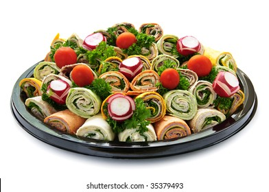 Isolated platter of assorted meat tortilla wraps