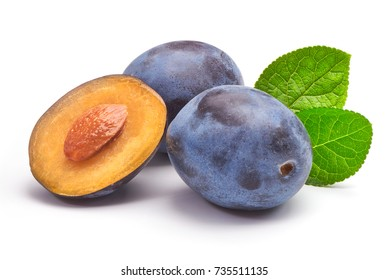 Isolated plums. One and a half of blue plum fruit with leaves isolated on white background