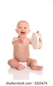 isolated portait baby playing tamborine