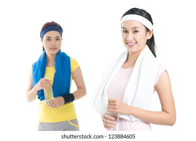 Isolated portrait of active young women after a workout