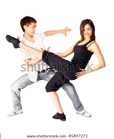 isolated portrait of asian guy and european girl dancing hustle
