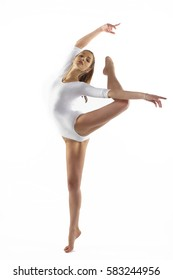 isolated portrait of beautiful young blonde woman gymnast training stretching exercise