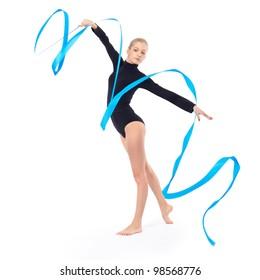 isolated portrait of beautiful young blonde woman gymnast training calilisthenics exercise with blue ribbon