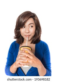 Isolated portrait of beautiful young  woman drinking in yellow paper cup with straw on white background.