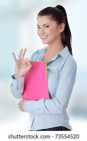 Isolated portrait of a beautiful young woman student gesturing.