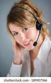 isolated portrait of cheerful blonde telephone operator