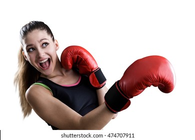 Isolated portrait of girl in red boxing gloves afraid to be punched in face. Concept of rookie sportswoman