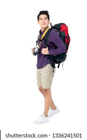 Isolated Portrait of handsome young attractive asian tourist man in casual attire carrying backpack and camera, studio shot white background