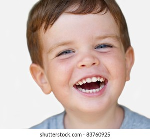 Isolated portrait of a laughing kid with nice teeth