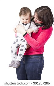 Isolated portrait of mother holding baby boy.