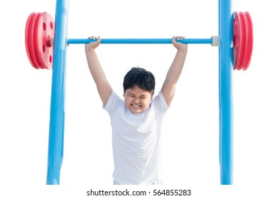 Isolated portrait of obese fat boy exercising weight lifting. Childhood, sports, strength, active lifestyle concept