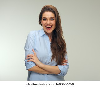 Isolated portrait of positive emotional woman standing with crossed arms.