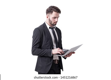 Isolated portrait of serious young businessman with beard working with laptop computer. Concept of hi tech.