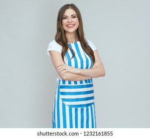 Isolated portrait of smiling woman wearing cook apron .