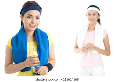 Isolated portrait of sportive young ladies resting after their usual workout