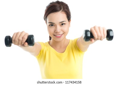 Isolated portrait of a sporty girl working out with dumbbells