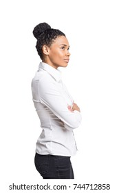 Isolated portrait of a strong and independent African American woman wearing a white shirt and standing with crossed arms.