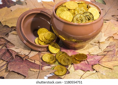 Isolated pot with golden coins. Abstract photo of lucky.