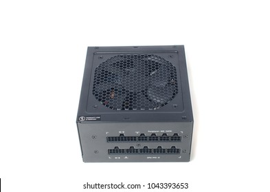 Isolated power supply unit on white background, modular connectors on the front side