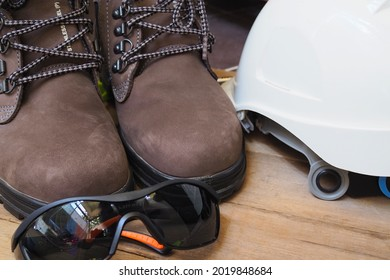 Isolated PPE set Safety Glasses, Safety Shoes or Boots and Hard hat