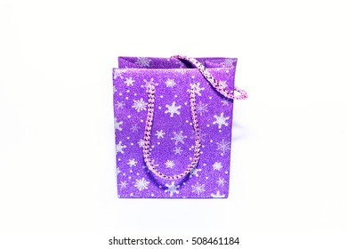 Isolated purple christmas gift bag with shiny snowflakes.View on top