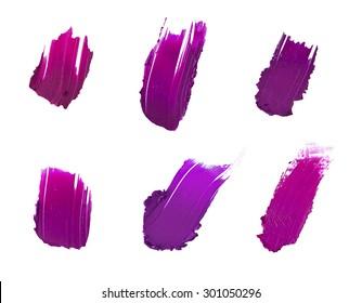 Isolated purple lipstick samples set