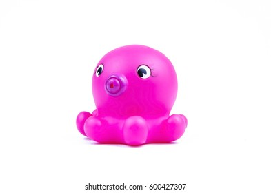 Isolated purple rubber octopus toy in profile on white background