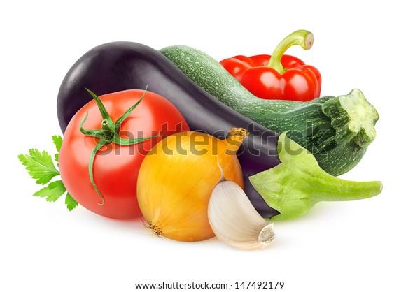 Isolated ratatouille ingredients. Various fresh vegetables (eggplant, zucchini, tomato, onion, pepper, garlic) isolated on white background