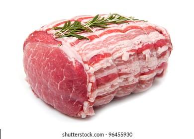 isolated raw roast beef on white background