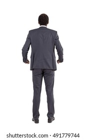 Isolated rear view of African American businessman holding invisible railing near his waist. Concept of tension and stress at work and inability to relax and take it easy