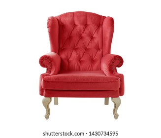 Isolated red armchair. Vintage velvet chair on a white background. Insulated furniture